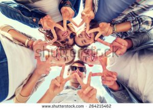 stock-photo-summer-holidays-and-teenage-concept-group-of-teenagers-showing-peace-or-victory-gesture-264215462